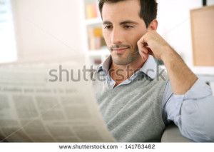 stock-photo-man-at-home-reading-newspaper-141763462