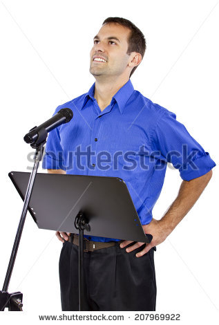 stock-photo-businessman-on-a-podium-making-a-speech-or-announcement-207969922