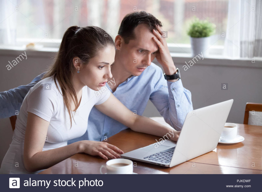 young-couple-disappointed-getting-bad-news-email-on-laptop-PJKDWF